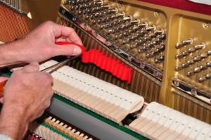 Before you buy an expensive used piano have it evaluated by a piano tuner.